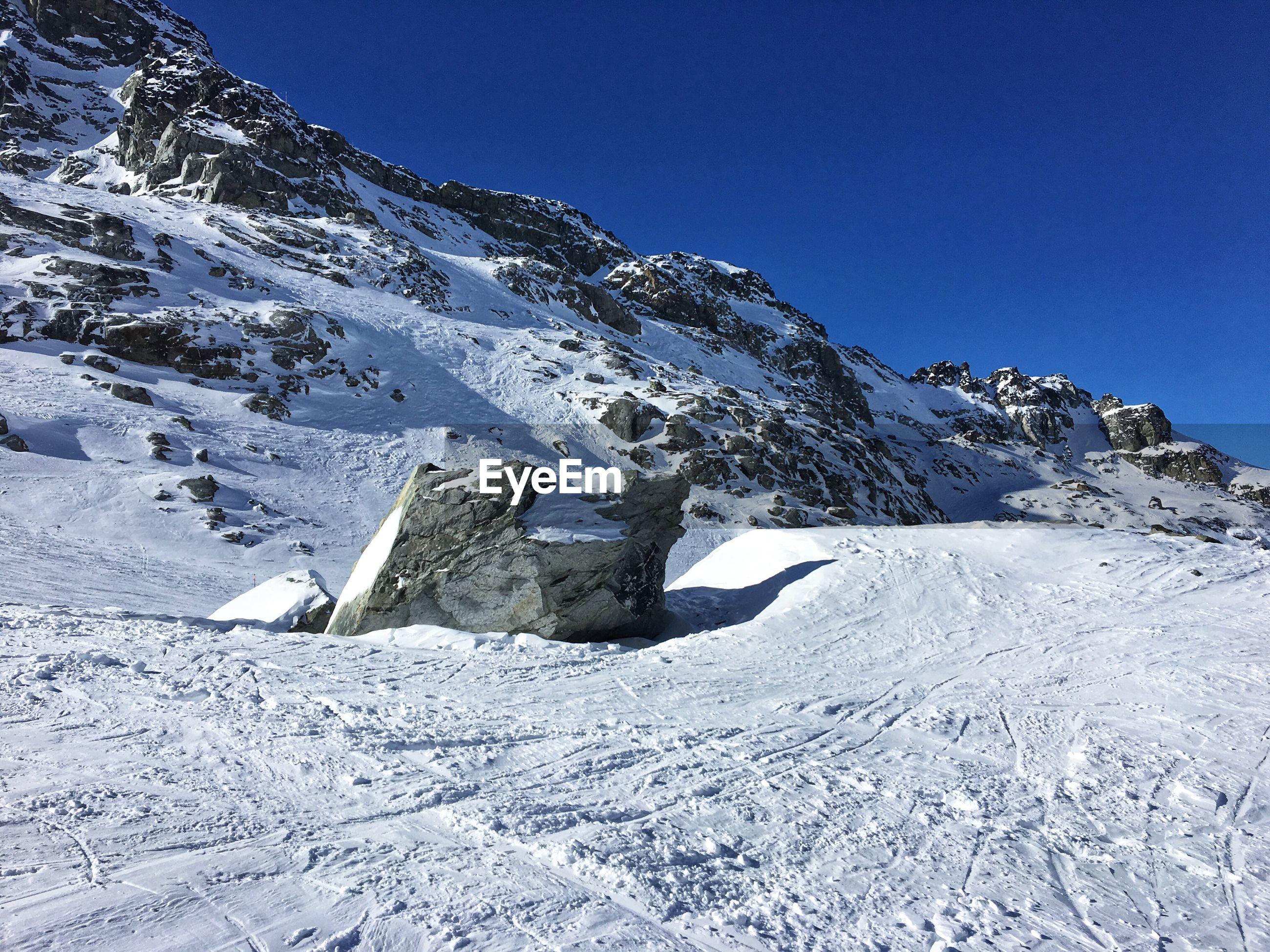SNOWCAPPED MOUNTAIN AGAINST CLEAR BLUE SKY