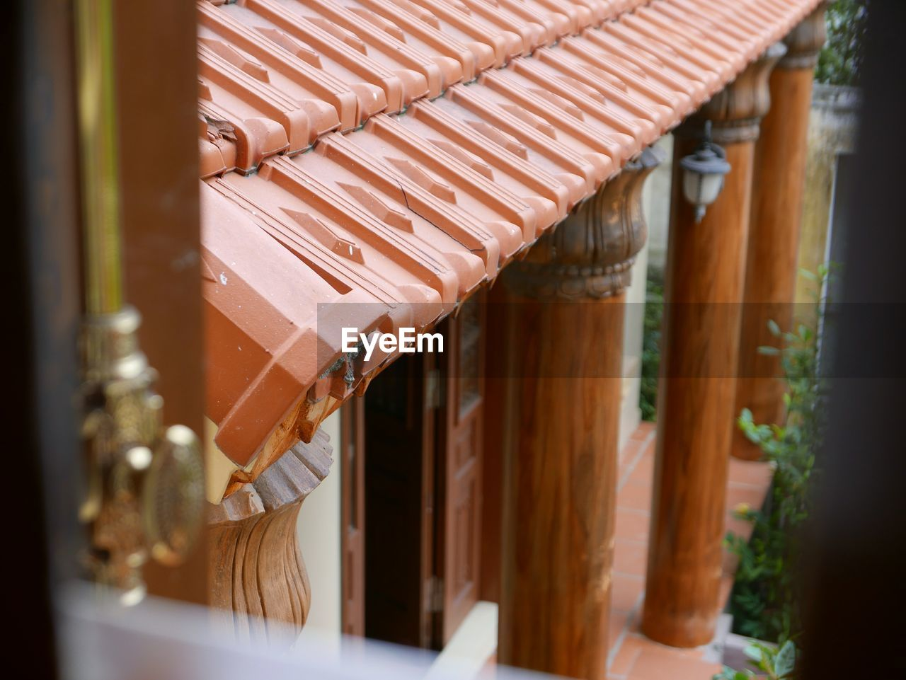 High angle view of traditional building seen through window