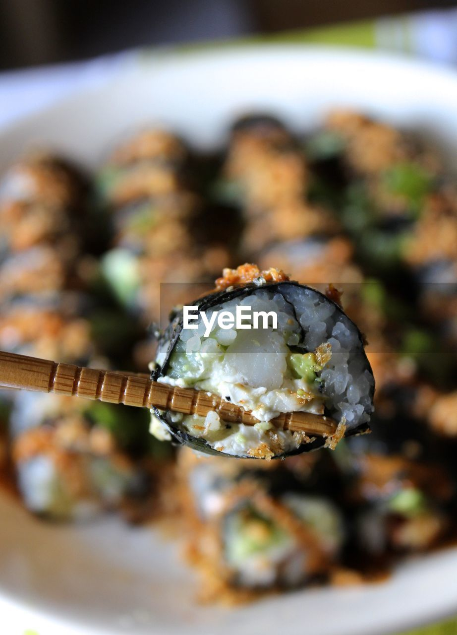 High Angle View Of Chopsticks With Sushi