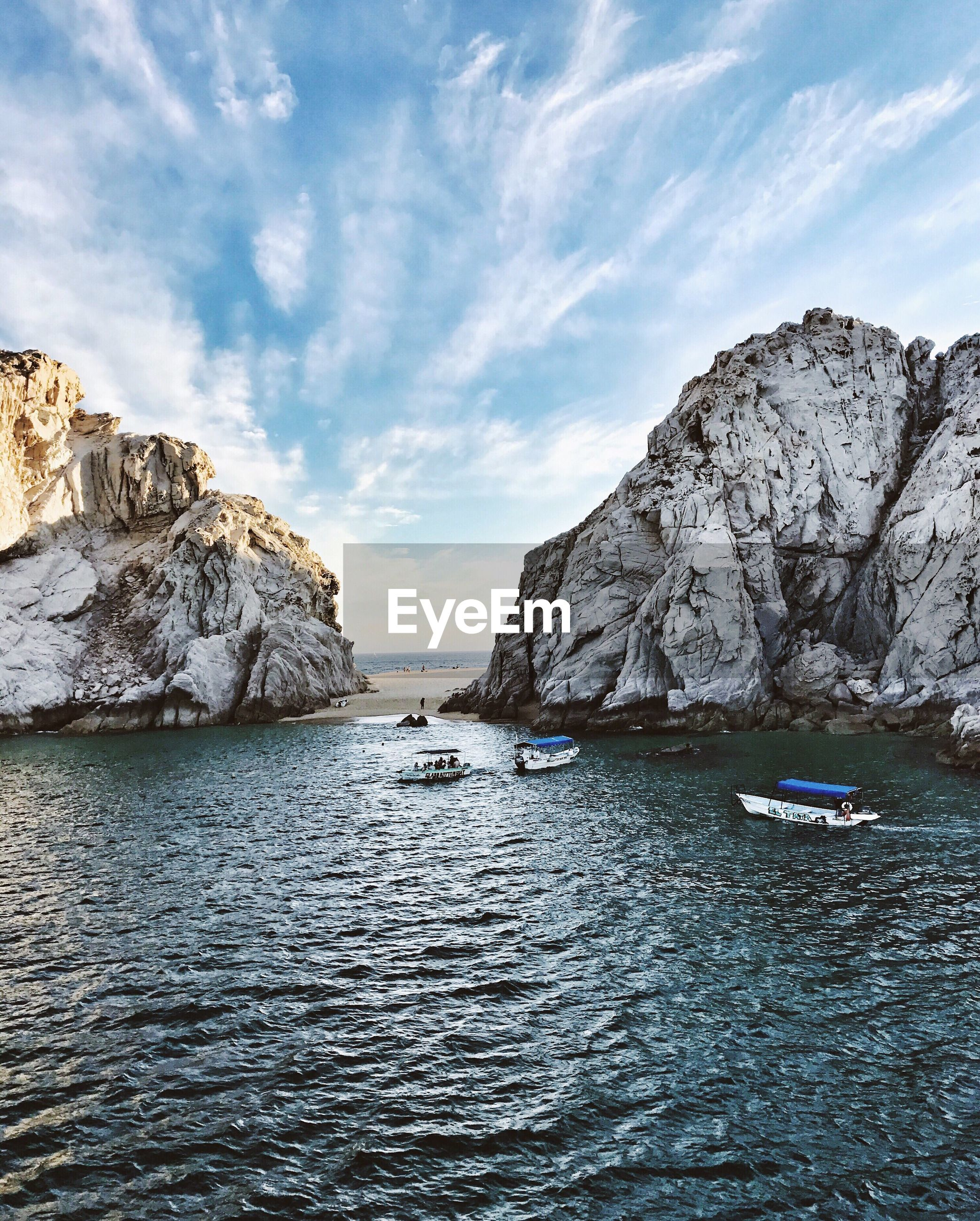 SCENIC VIEW OF SEA BY ROCKS AGAINST SKY
