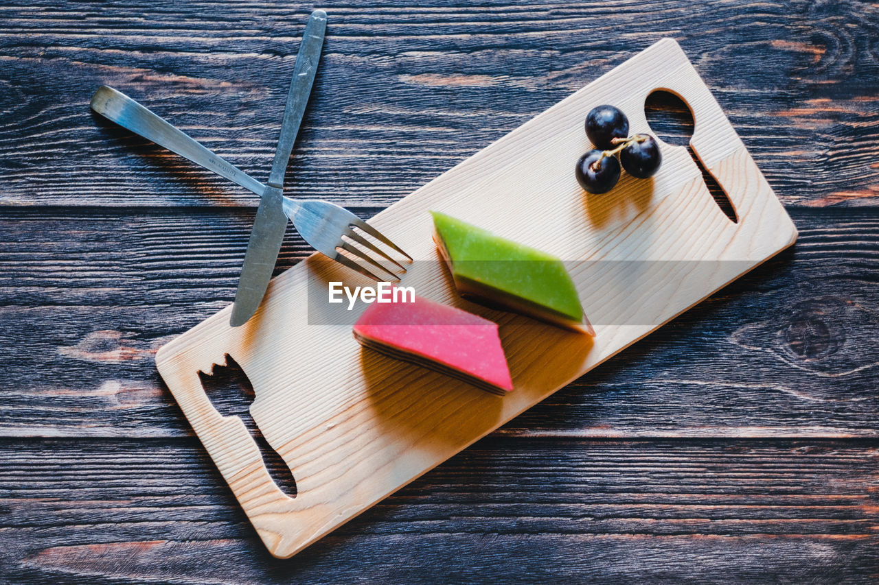wood - material, table, no people, still life, indoors, food, food and drink, high angle view, multi colored, variation, choice, group of objects, close-up, fruit, medium group of objects, healthy eating, cutting board, freshness, knife, kitchen utensil, wood grain