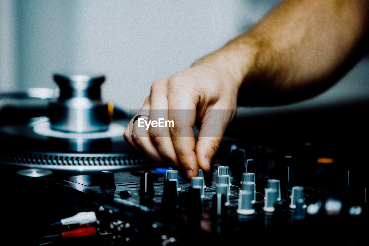 Cropped Hand Of Man Mixing Music