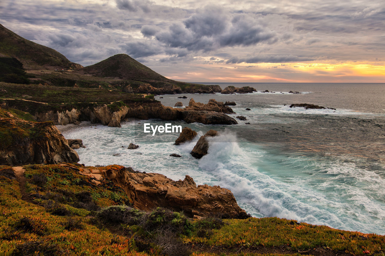water, sea, sky, beauty in nature, scenics - nature, cloud - sky, motion, sunset, beach, nature, land, rock, mountain, no people, rock - object, solid, sport, wave, tranquil scene, outdoors, rocky coastline