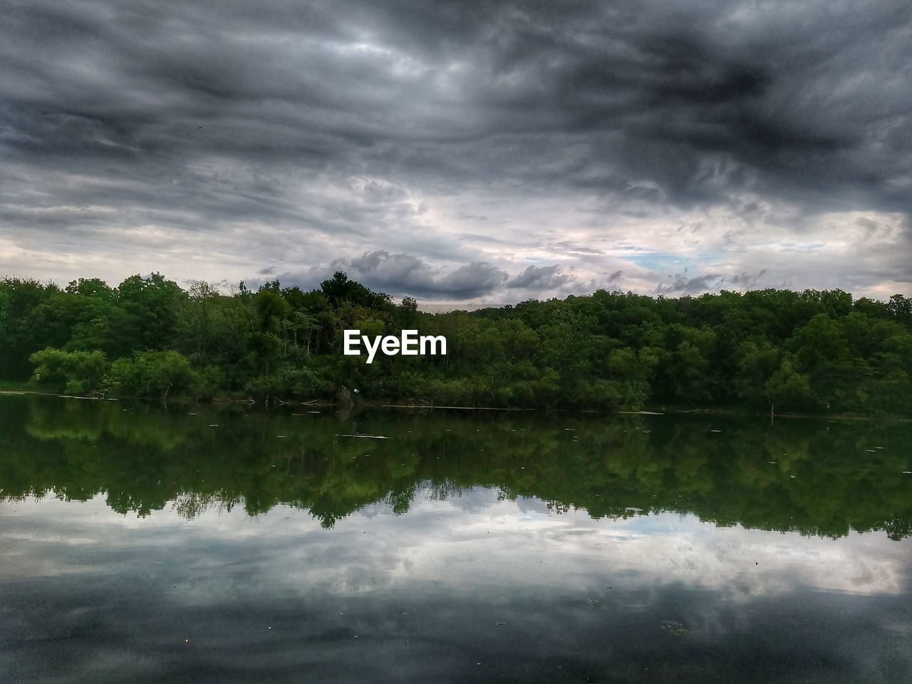 reflection, water, tree, sky, cloud - sky, lake, waterfront, nature, beauty in nature, tranquil scene, no people, scenics, outdoors, tranquility, day