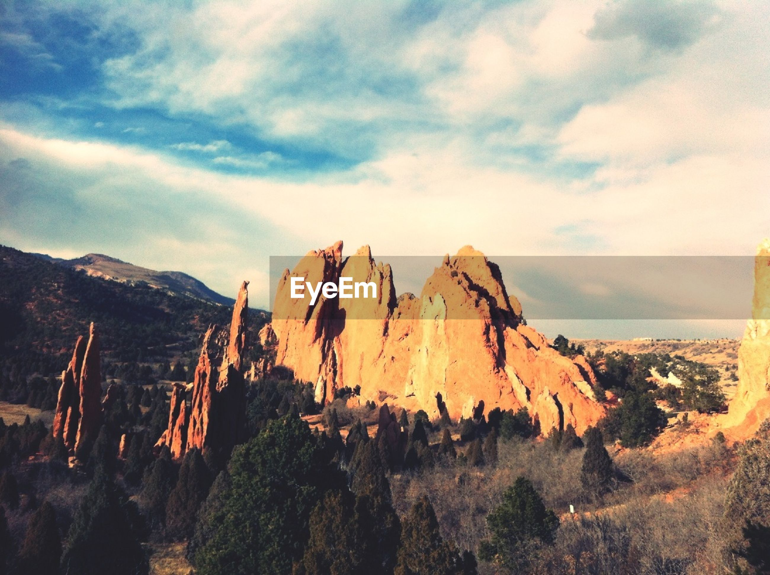 mountain, rock formation, sky, physical geography, scenics, geology, tranquil scene, tranquility, beauty in nature, landscape, nature, cloud - sky, rocky mountains, rock - object, mountain range, non-urban scene, eroded, travel destinations, arid climate, idyllic