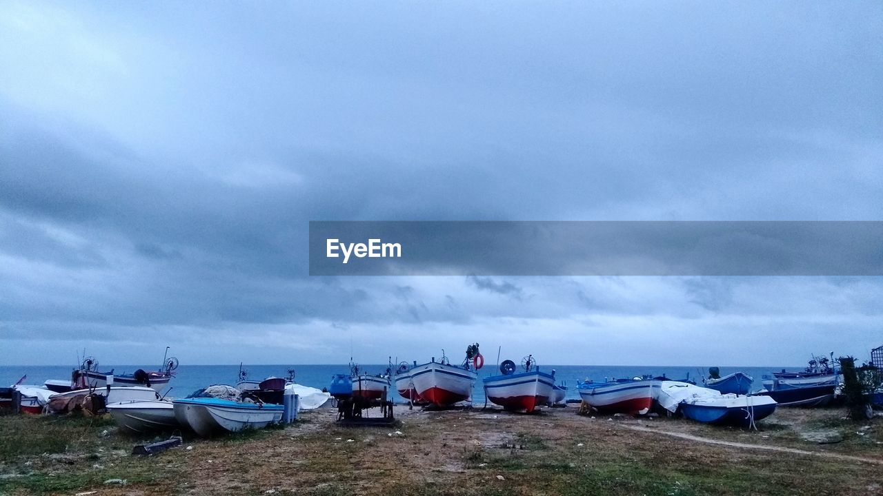 nautical vessel, cloud - sky, boat, transportation, sea, sky, nature, mode of transport, moored, water, beach, tranquility, outdoors, horizon over water, scenics, tranquil scene, beauty in nature, dusk, day, harbor, no people, yacht