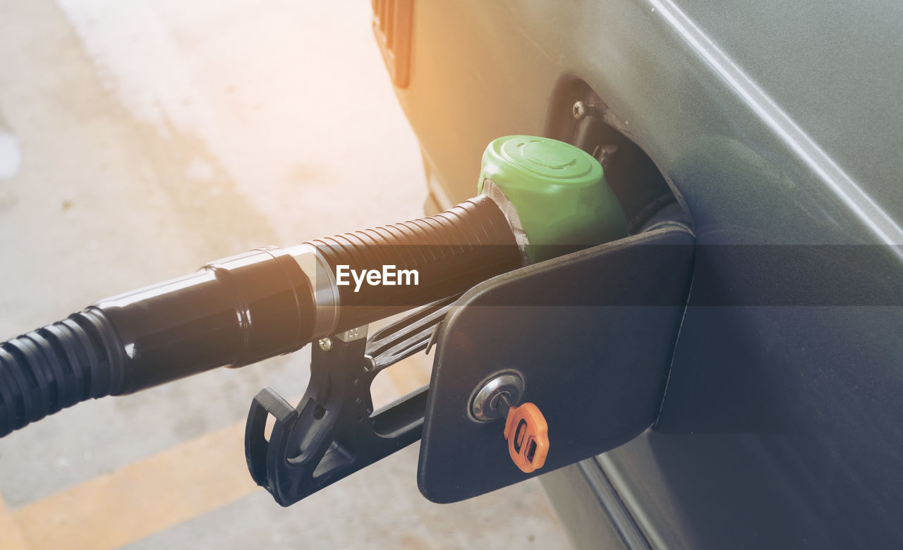 High Angle View Of Filling Gasoline Fuel In Car