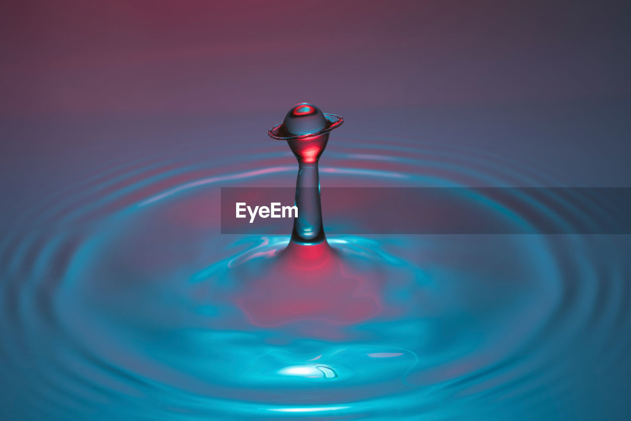Close-Up Of Drop Splashing In Water