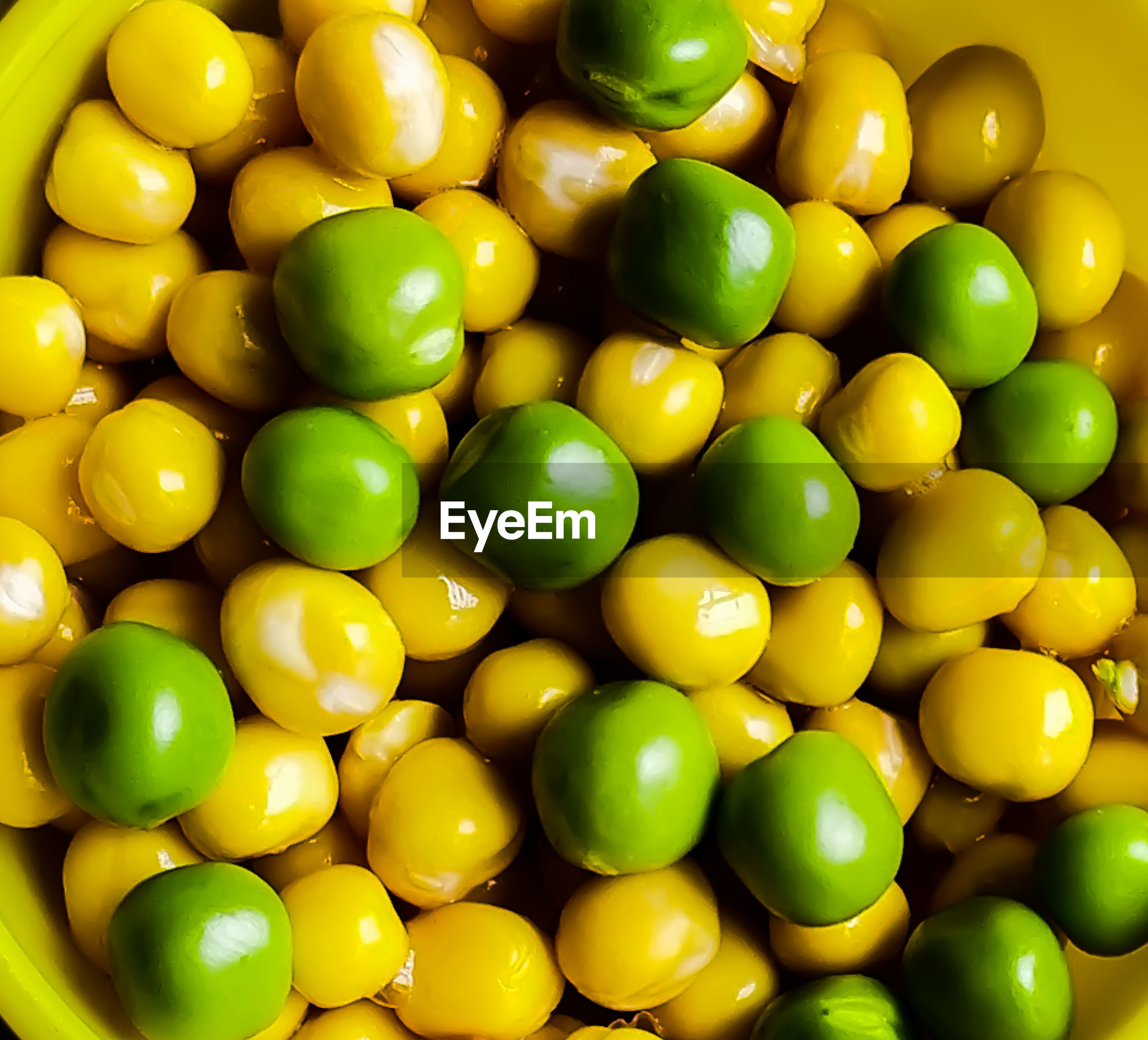Full frame shot of green and yellow peas