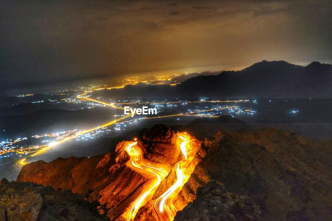 geology, nature, beauty in nature, night, outdoors, no people, sky, power in nature, scenics, illuminated, physical geography, heat - temperature, mountain, tranquility, motion, erupting, sunset, lava, water