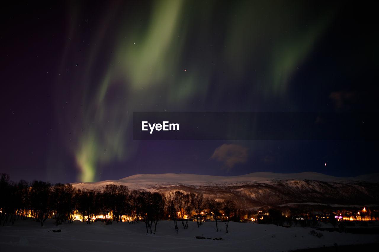 Frozen Landscape Against Sky At Night