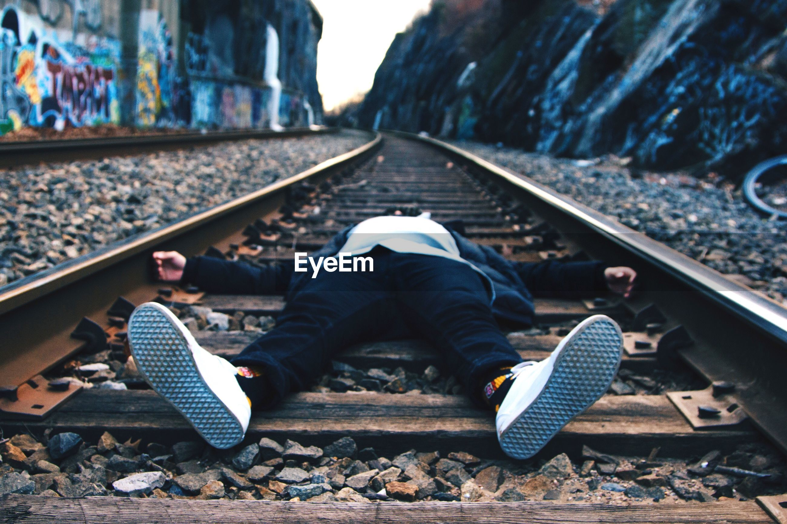 High angle view of man on railroad tracks