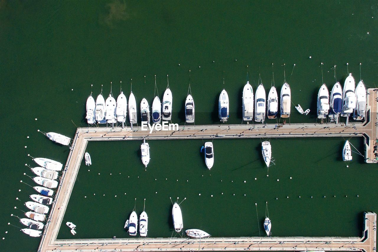 Aerial View Of Boats On Pier At Lake