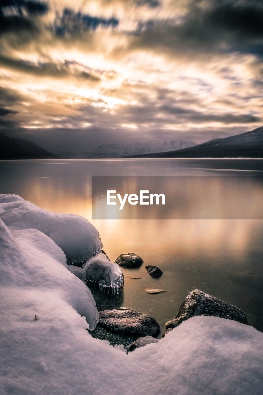 water, sunset, beauty in nature, nature, scenics, sky, tranquil scene, no people, tranquility, outdoors, cold temperature, lake, winter, reflection, cloud - sky, frozen, snow, iceberg, day