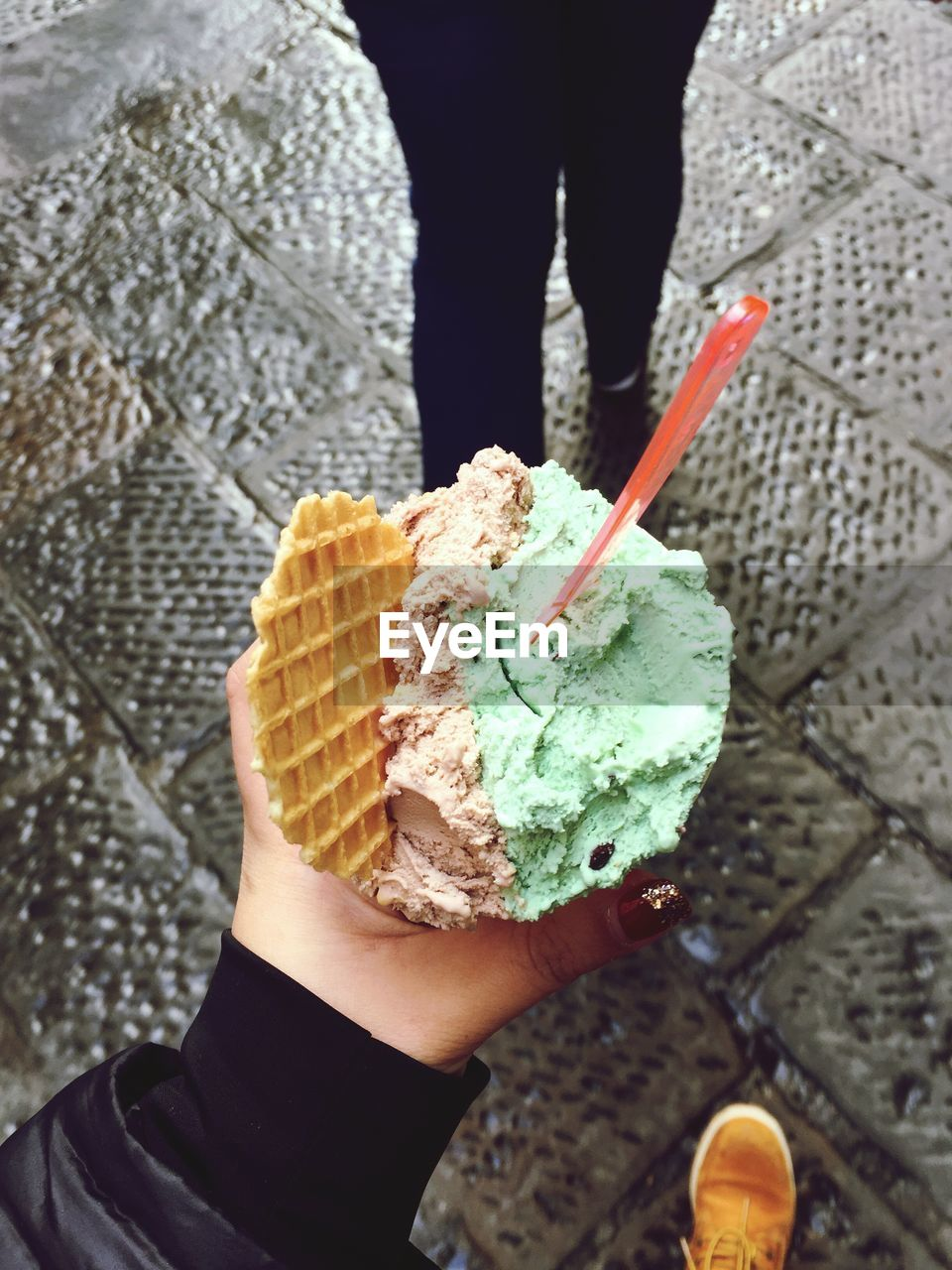 Close-Up Of Woman Holding Ice Cream Cone