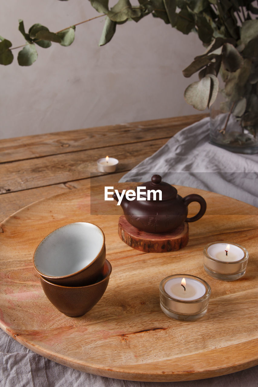 CUP OF TEA CUPS ON TABLE