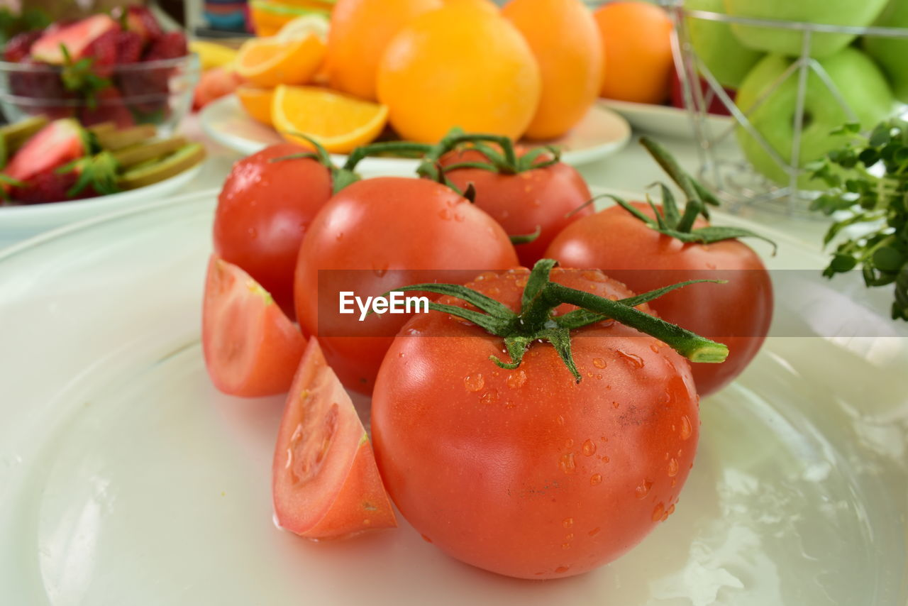 food and drink, food, fruit, healthy eating, vegetable, freshness, wellbeing, tomato, still life, red, close-up, no people, indoors, raw food, container, plate, focus on foreground, high angle view, ripe, cherry tomato