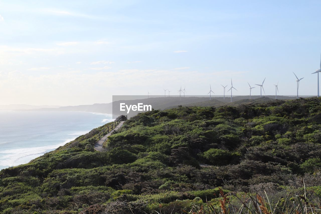 environmental conservation, fuel and power generation, renewable energy, beauty in nature, environment, scenics - nature, sky, alternative energy, wind turbine, sea, turbine, tranquility, land, tranquil scene, water, wind power, non-urban scene, nature, landscape, no people, outdoors, sustainable resources