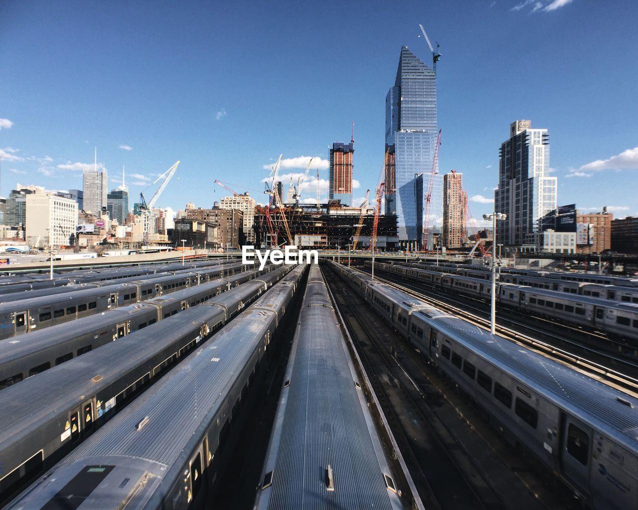 Trains at shunting yard in city