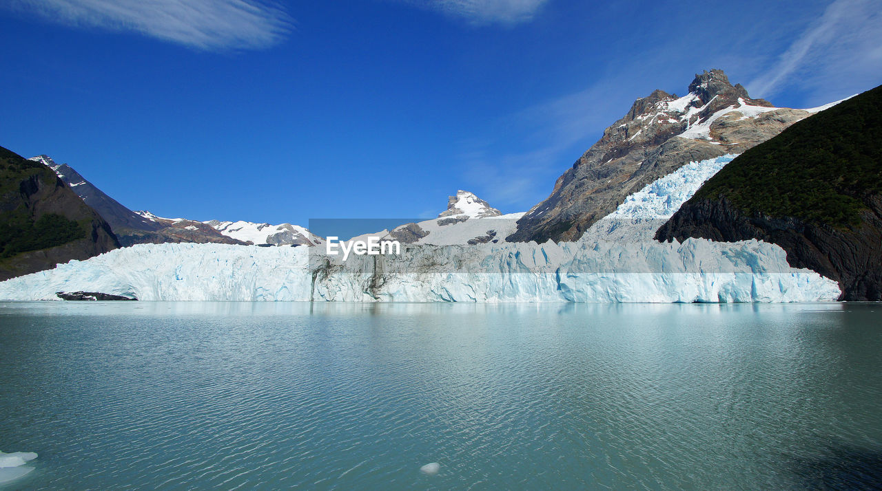 mountain, glacier, nature, ice, iceberg, beauty in nature, tranquil scene, global warming, melting, wilderness, tranquility, landscape, cold temperature, no people, scenics, snow, sea, water, outdoors, day, glacial, sky, range