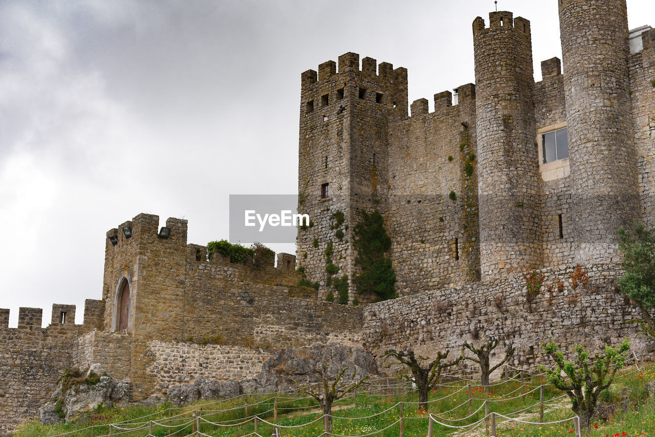 history, the past, architecture, built structure, building exterior, castle, building, ancient, sky, old ruin, old, fort, nature, travel destinations, wall, medieval, travel, tourism, no people, day, outdoors, ruined, stone wall, ancient civilization, deterioration, archaeology