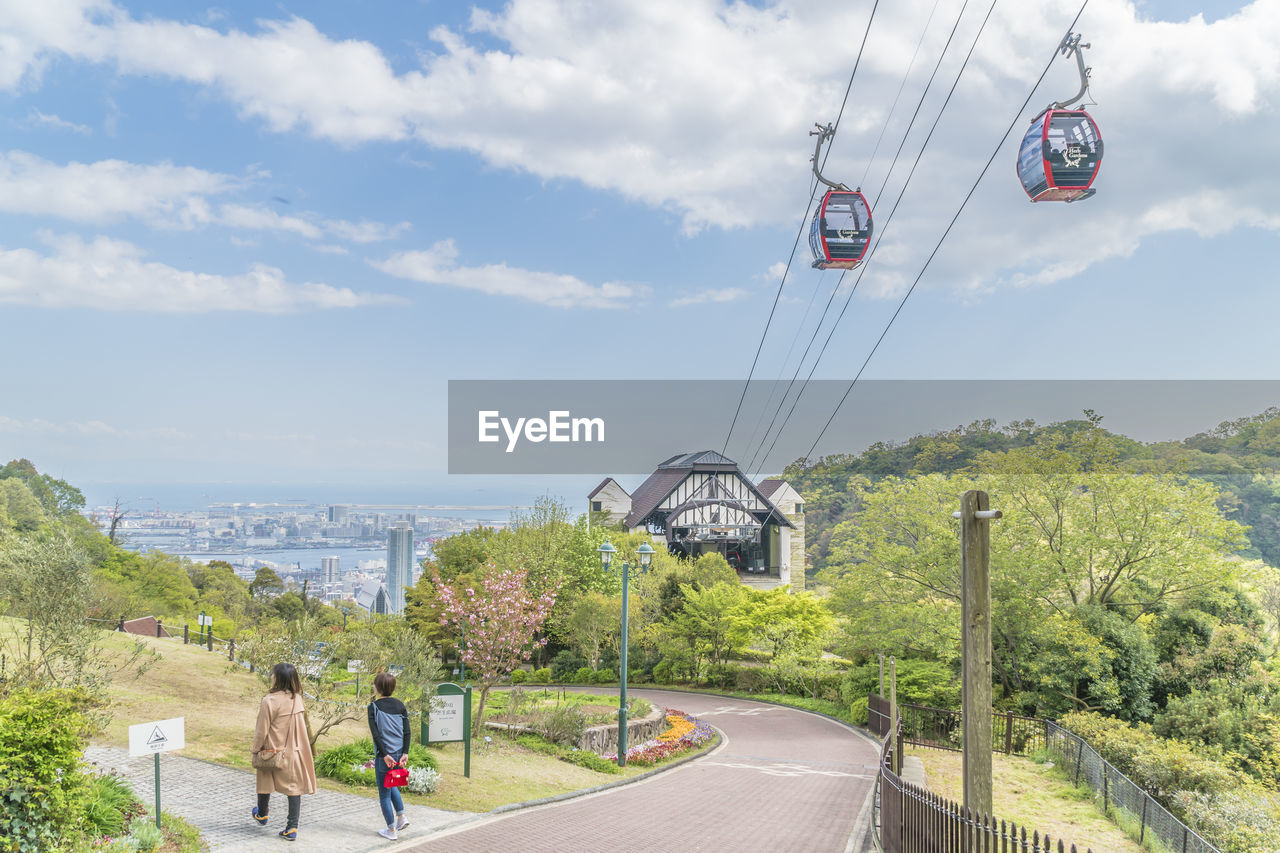 real people, sky, cloud - sky, nature, day, transportation, men, lifestyles, plant, leisure activity, tree, cable car, people, water, cable, architecture, beauty in nature, rear view, built structure, outdoors