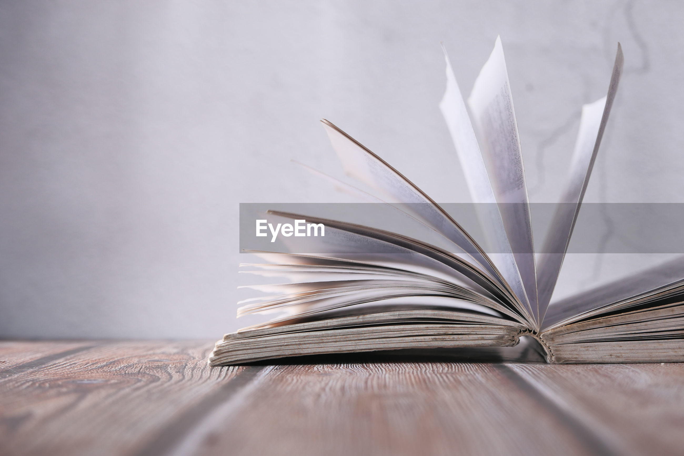 Close up of open book on table