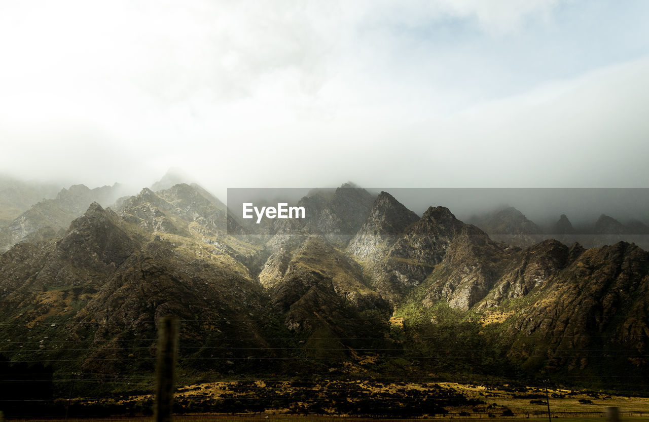 mountain, sky, beauty in nature, scenics - nature, landscape, tranquil scene, tranquility, cloud - sky, non-urban scene, environment, no people, nature, mountain range, plant, idyllic, tree, fog, day, land, outdoors, mountain peak