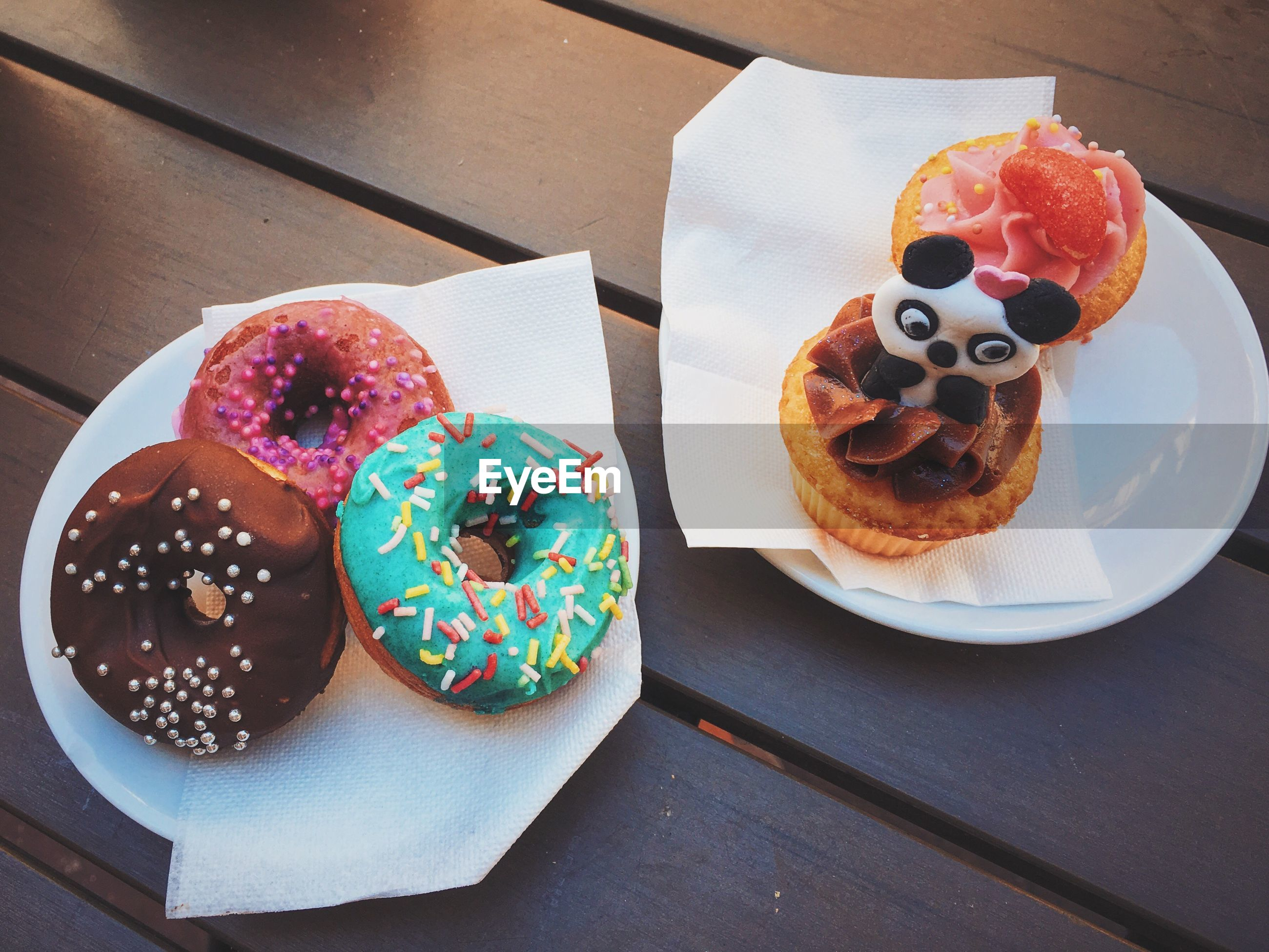 High angle view of donuts in plate on table