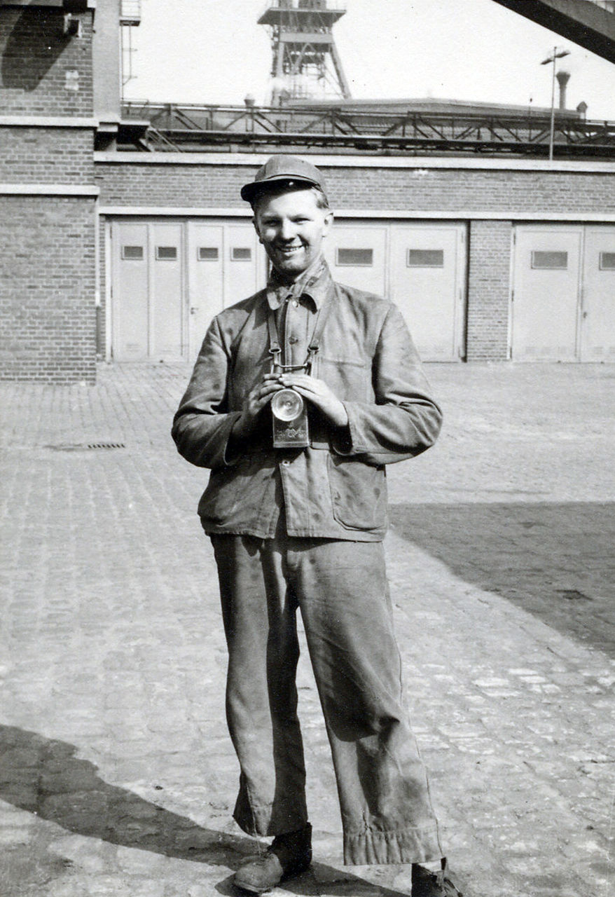 Portrait of smiling man with standing against factory
