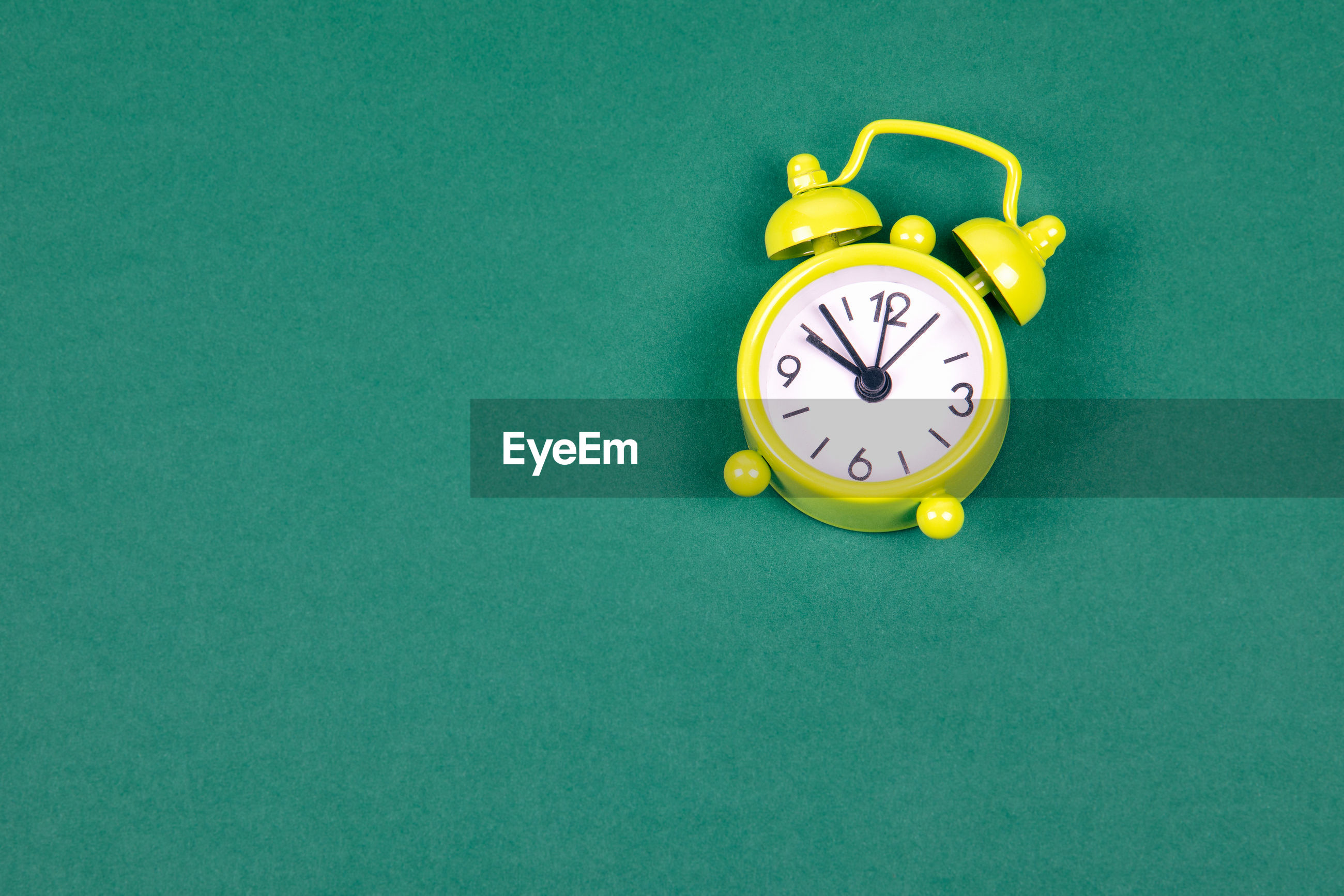 Close-up of clock on green background