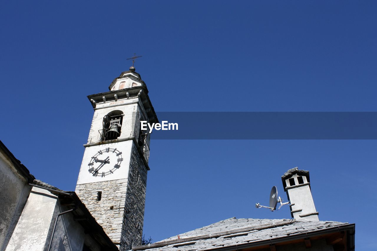 guidance, direction, communication, text, number, clock, clock tower, low angle view, day, architecture, weather vane, built structure, blue, no people, outdoors, bell tower, time, roman numeral, minute hand, clock face
