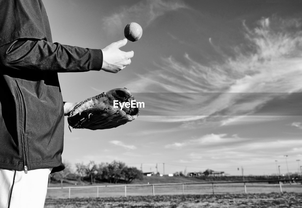 Man standing on soccer field against sky
