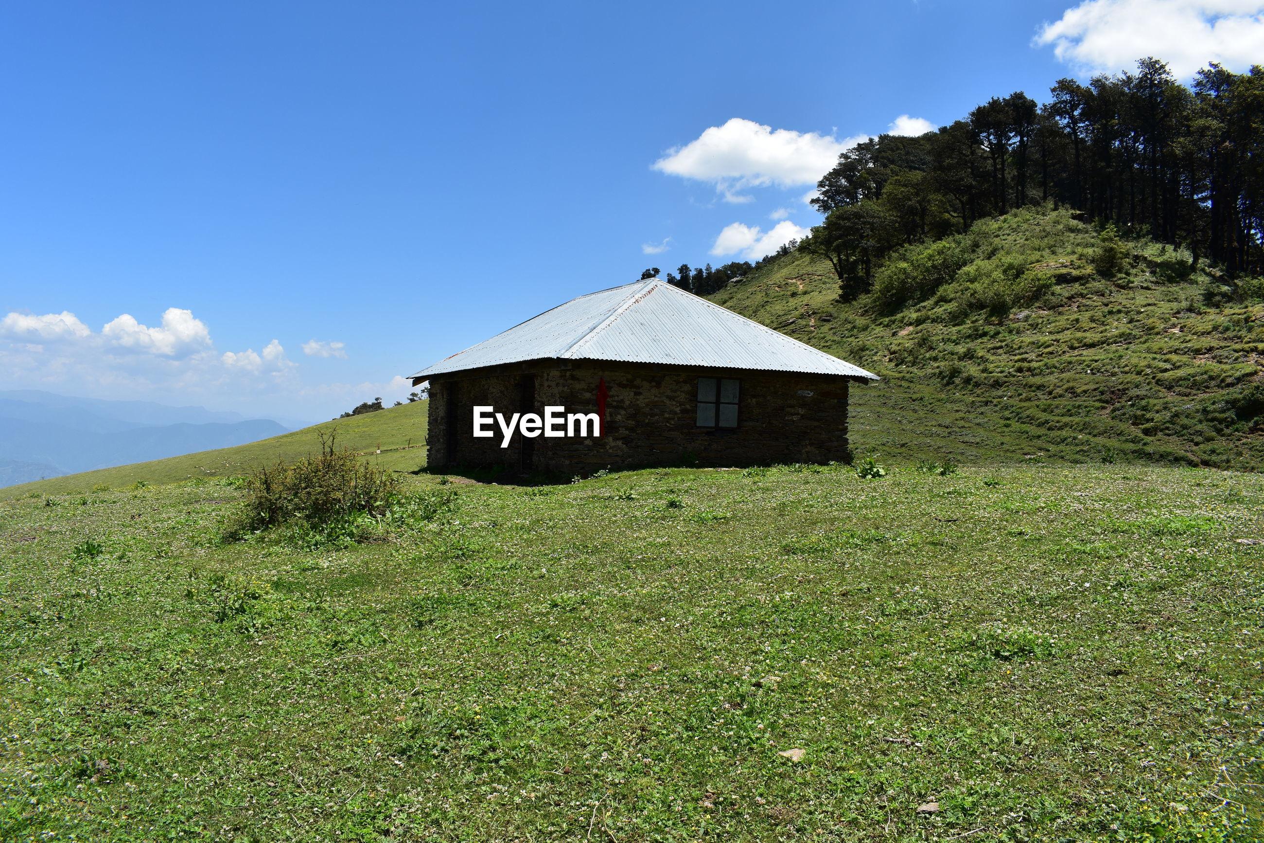 House on land against sky