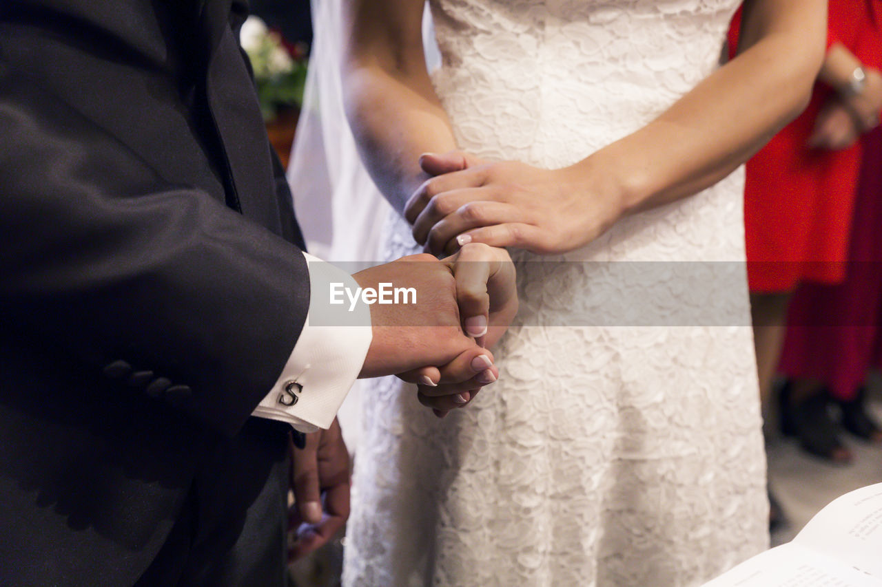 bride, wedding, midsection, newlywed, two people, real people, celebration, event, bridegroom, wedding dress, women, ceremony, love, togetherness, men, life events, religion, married, people, celebration event, hand, wedding ceremony, positive emotion, couple - relationship