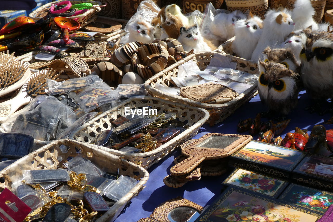 large group of objects, no people, high angle view, market, day, abundance, retail, choice, variation, for sale, animal, animal themes, collection, water, indoors, group of animals, market stall, sunlight, representation