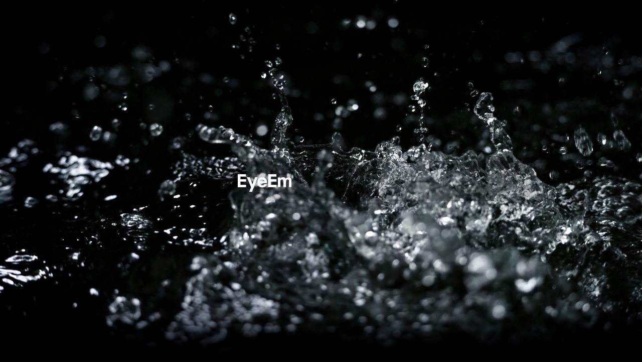 water, selective focus, drop, no people, nature, close-up, splashing, outdoors, motion, day, wet, freshness, beauty in nature, focus on foreground, winter, sunlight, blurred motion, food and drink, purity, flowing water, raindrop