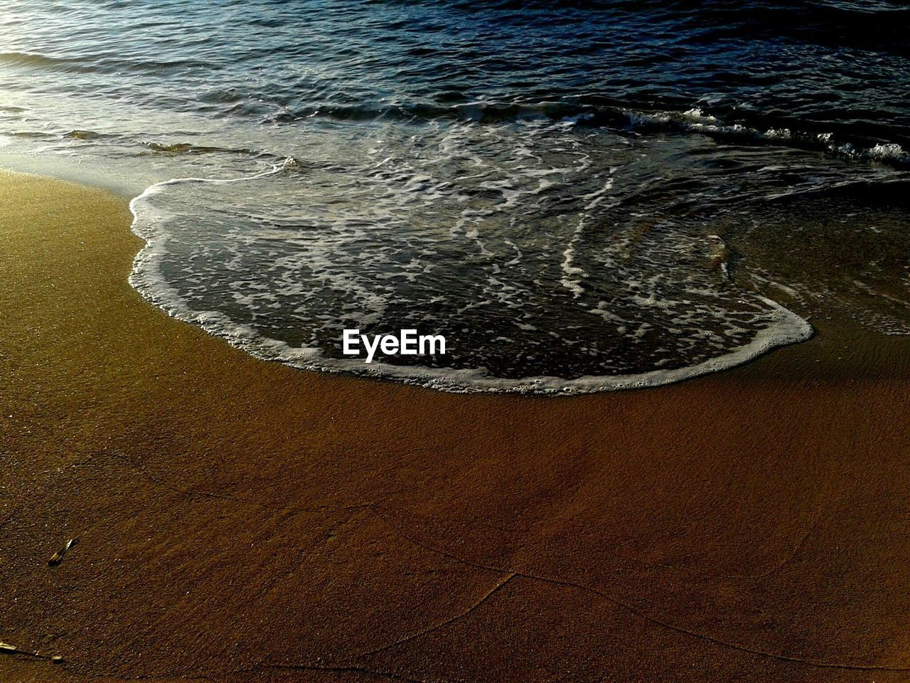 water, sea, wave, sand, beach, nature, shore, no people, high angle view, rippled, beauty in nature, outdoors, day, tide, scenics, close-up