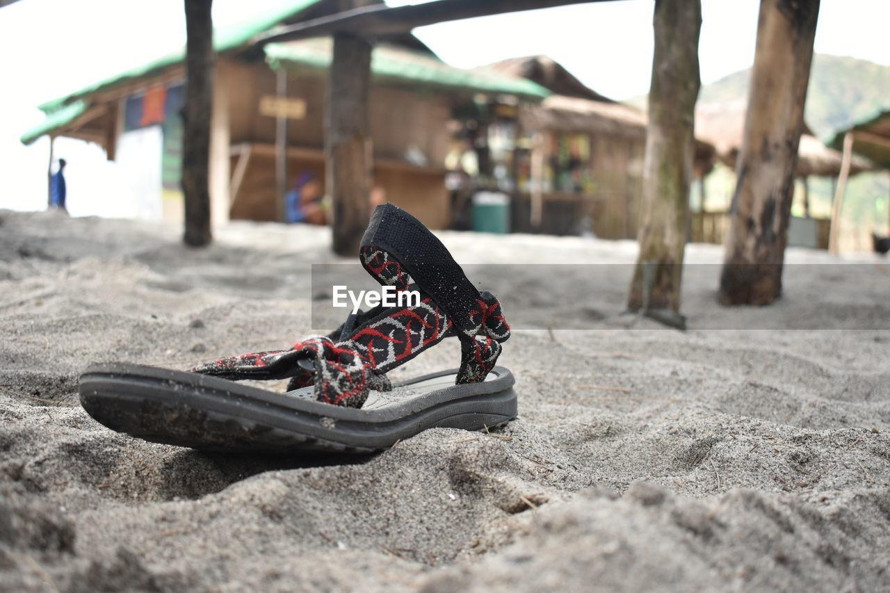Sandal at sandy beach