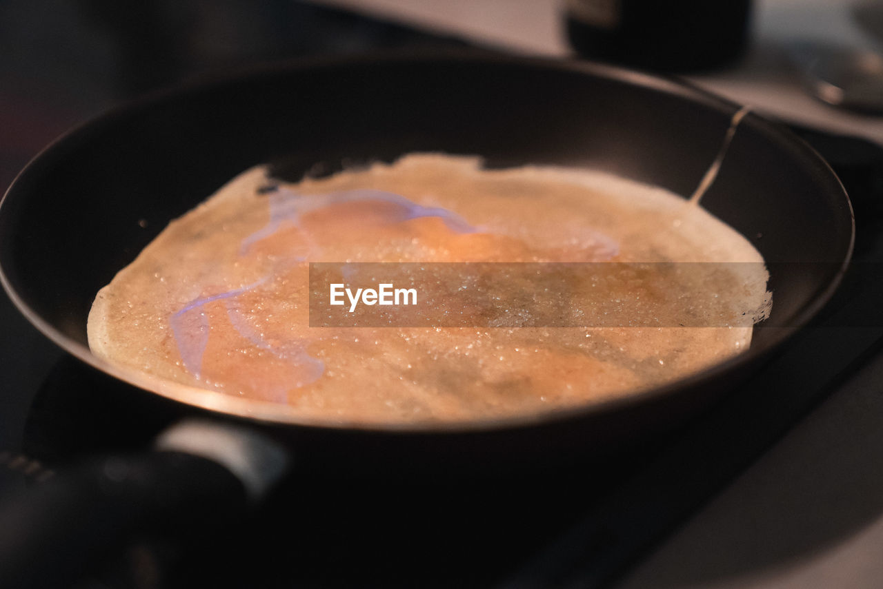 food and drink, food, kitchen utensil, indoors, close-up, freshness, still life, selective focus, household equipment, cooking pan, preparation, no people, high angle view, ready-to-eat, preparing food, sweet food, pan, frying pan, spoon, eating utensil, temptation