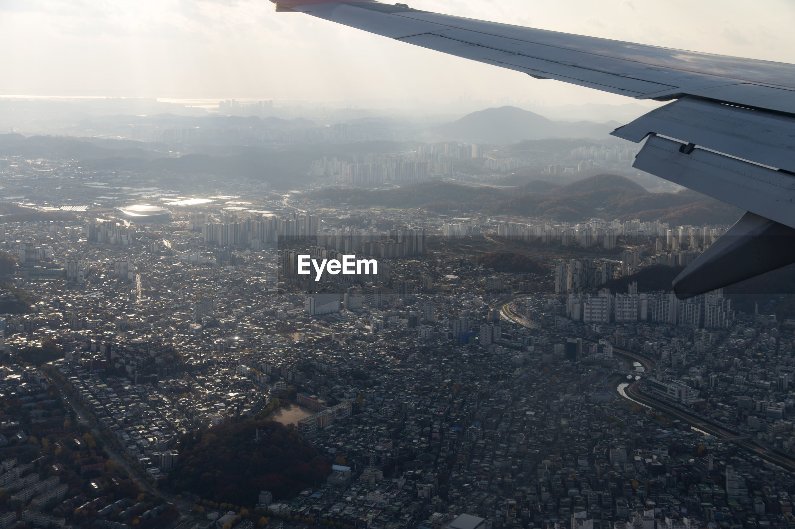 Cropped image of airplane over cityscape