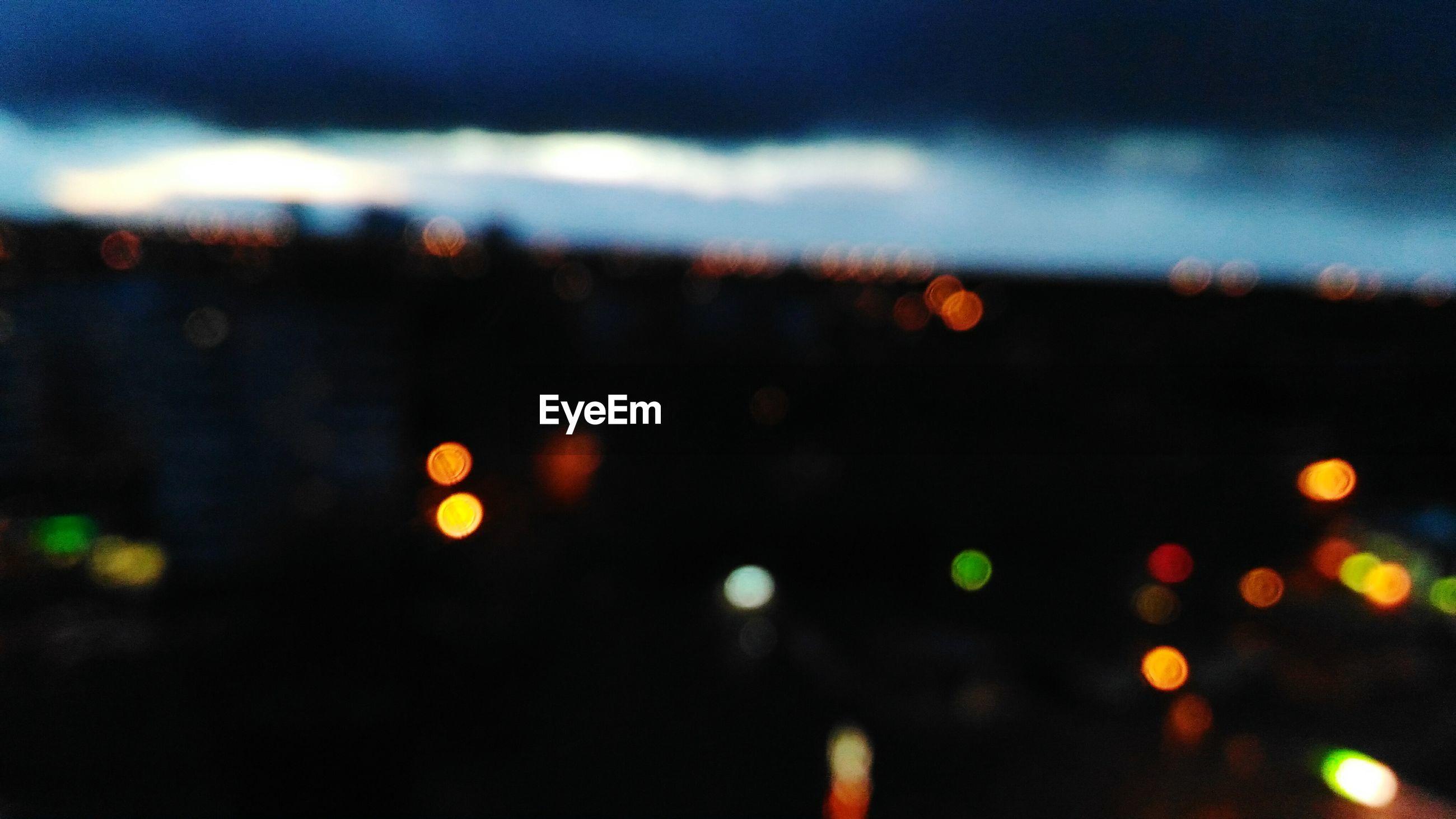 illuminated, defocused, night, city, no people, close-up, sky, rainy season, backgrounds, outdoors, nature
