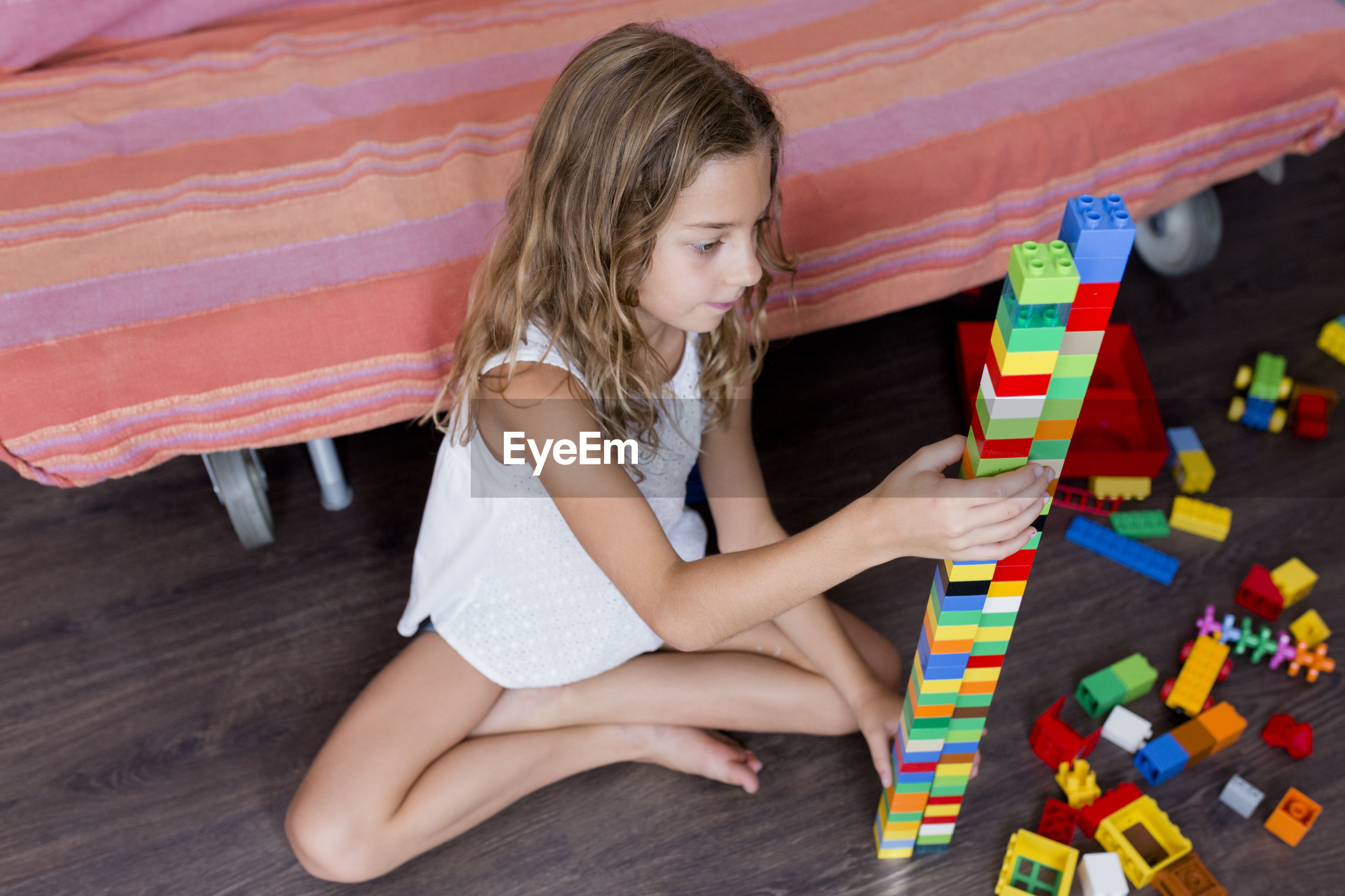 High angle view of girl playing with toy blocks