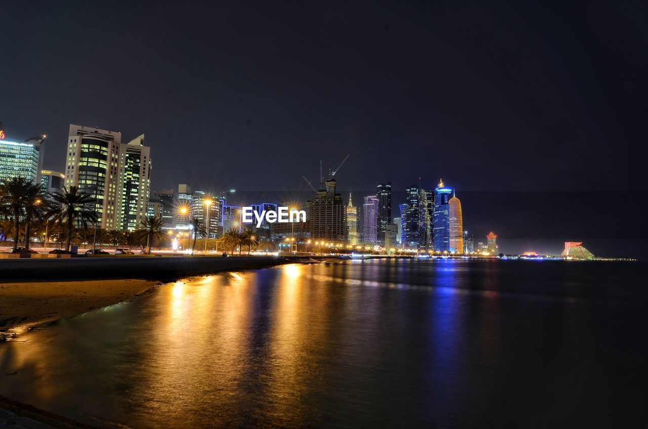 building exterior, architecture, built structure, illuminated, night, water, city, building, sky, waterfront, office building exterior, reflection, urban skyline, landscape, cityscape, river, modern, skyscraper, nature, no people, tall - high, outdoors, financial district, nightlife