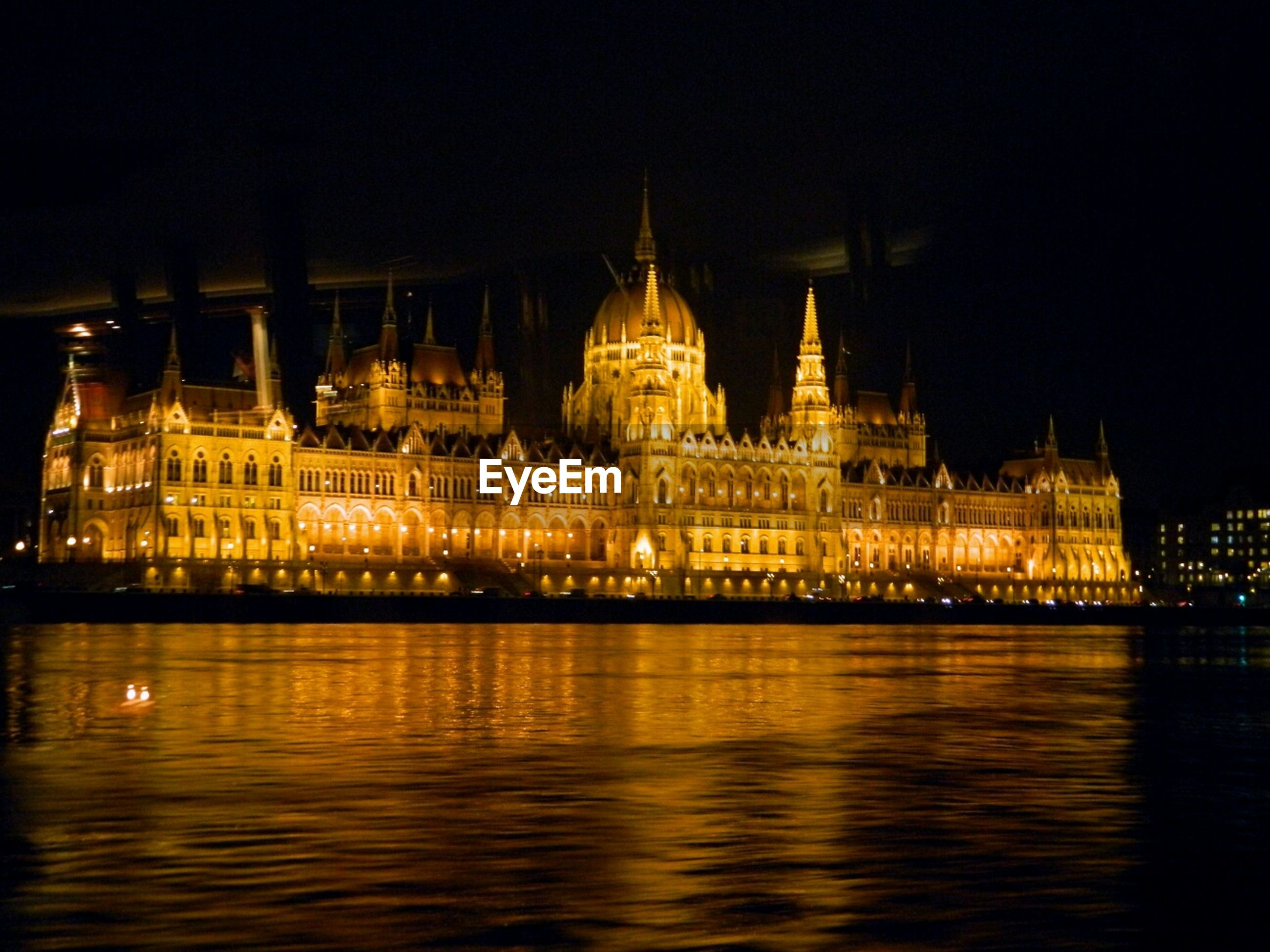 Parliament building by river at night