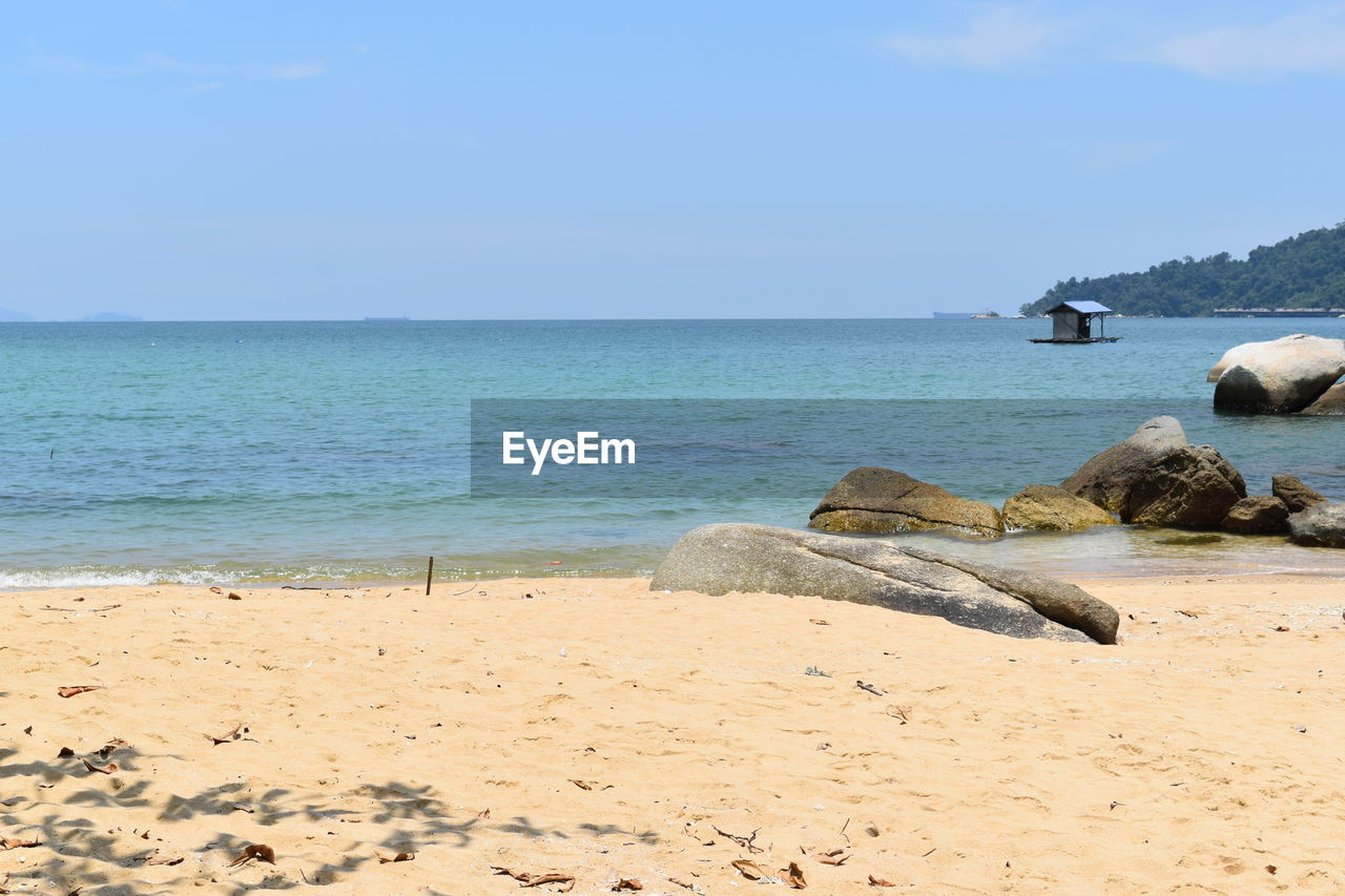 sea, horizon over water, water, scenics, tranquil scene, nature, tranquility, beauty in nature, rock - object, beach, sky, day, outdoors, sand, no people, blue, clear sky