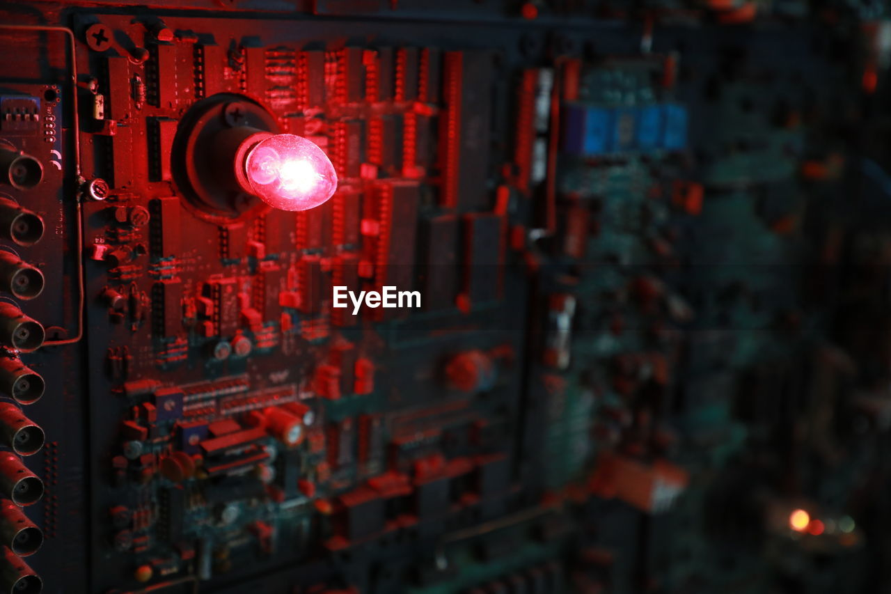 red, illuminated, no people, communication, technology, close-up, selective focus, focus on foreground, lighting equipment, architecture, art and craft, text, indoors, night, safety, craft, hanging, security, glowing, electrical equipment