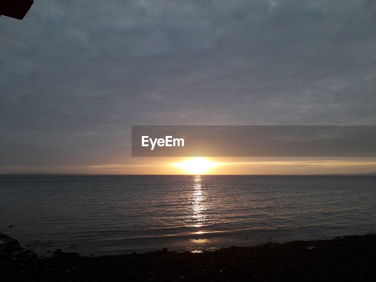 sky, water, sea, sunset, beauty in nature, tranquility, scenics - nature, sun, horizon, tranquil scene, horizon over water, nature, cloud - sky, no people, beach, land, reflection, sunlight, idyllic, outdoors
