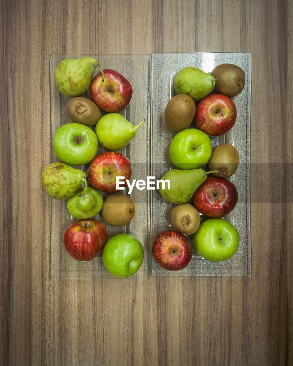healthy eating, food and drink, wellbeing, food, fruit, freshness, directly above, apple - fruit, indoors, variation, choice, large group of objects, wood - material, red, studio shot, high angle view, group of objects, still life, no people, table, apple