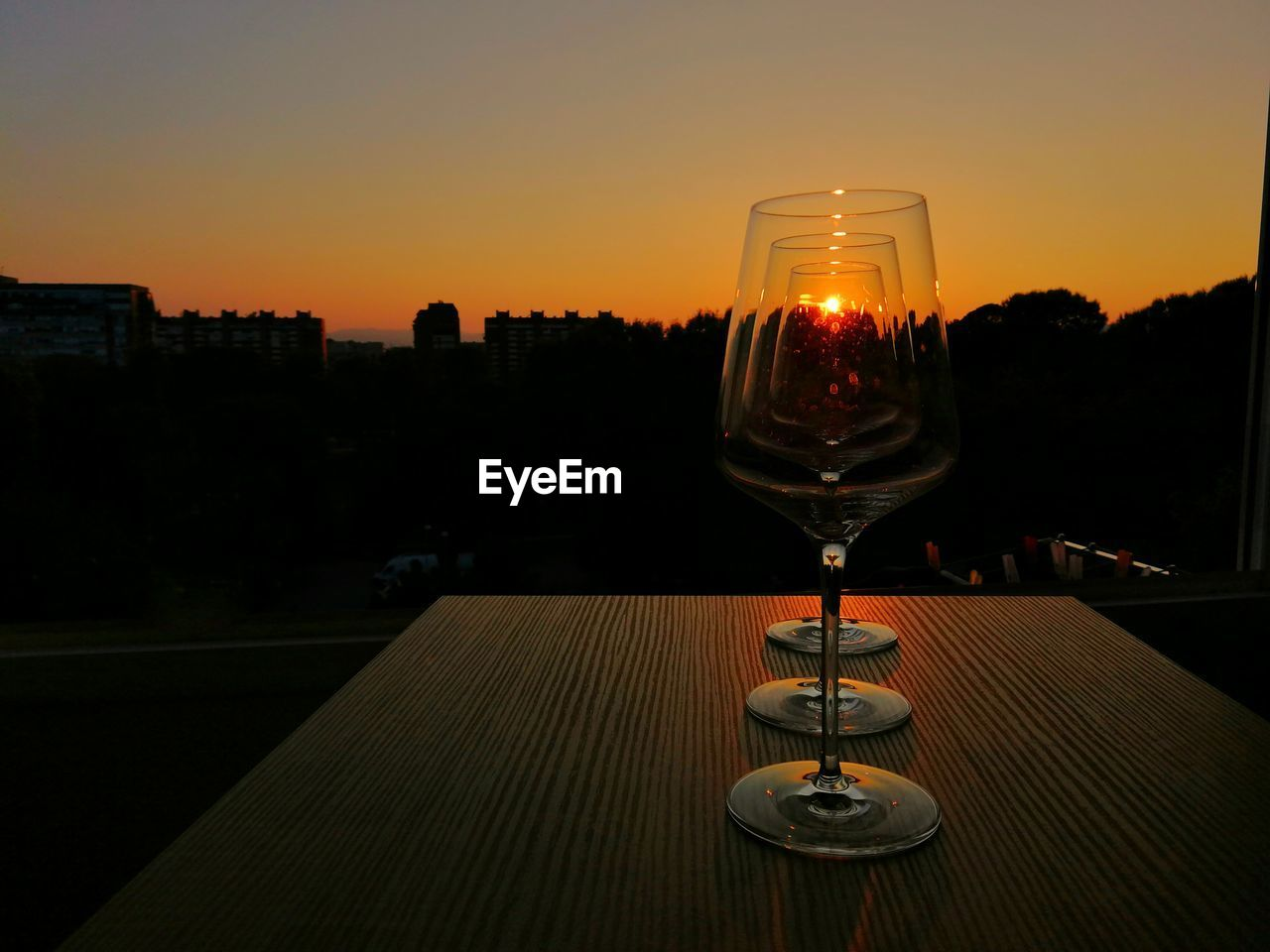 sunset, sky, alcohol, glass, wineglass, refreshment, drink, wine, food and drink, no people, glass - material, orange color, transparent, nature, table, still life, architecture, drinking glass, building exterior, freshness